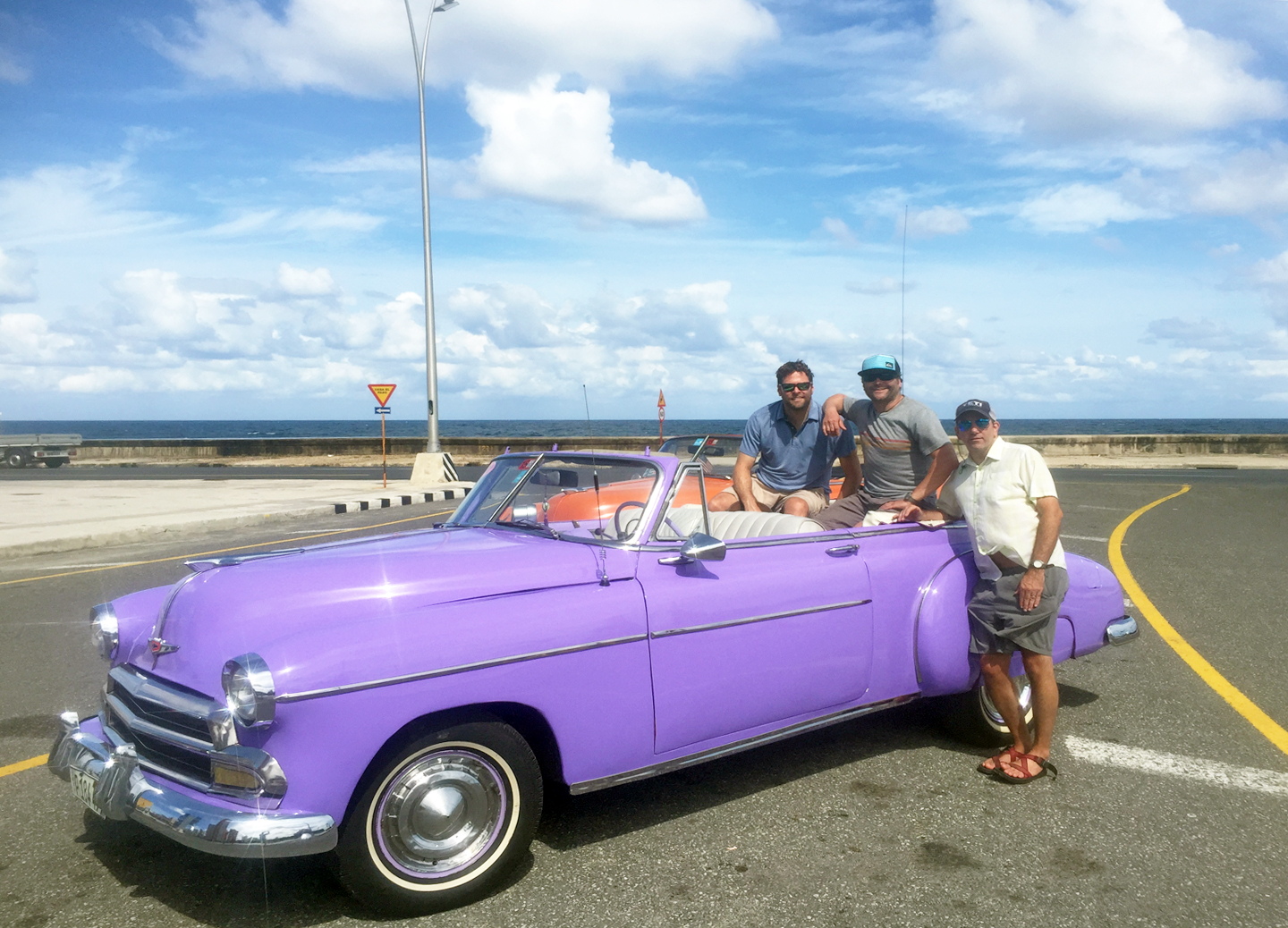 A purple classic convertible American car on the Malecon in Havana, Cuba
