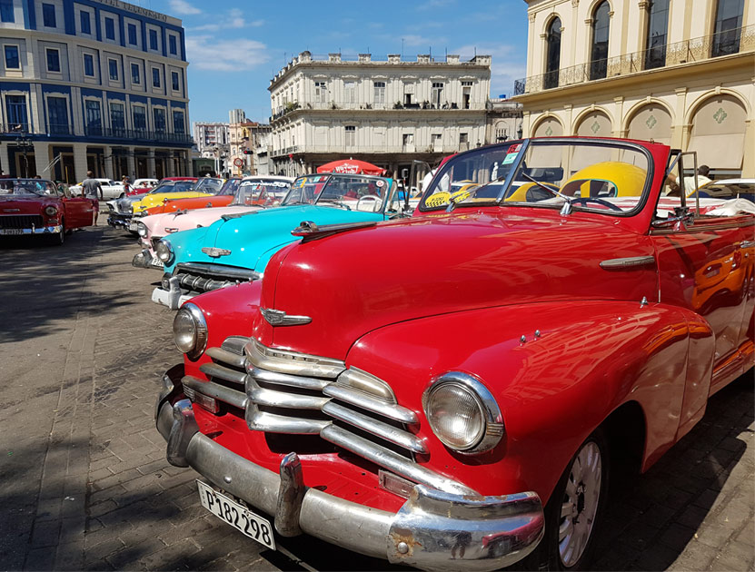 A line of convertible classic cars in Havana. Cuba
